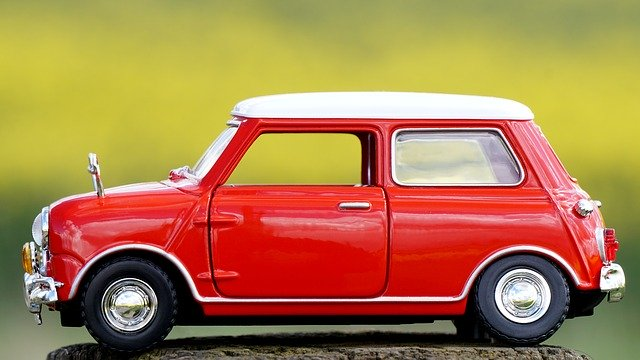 a small red car standing on stone