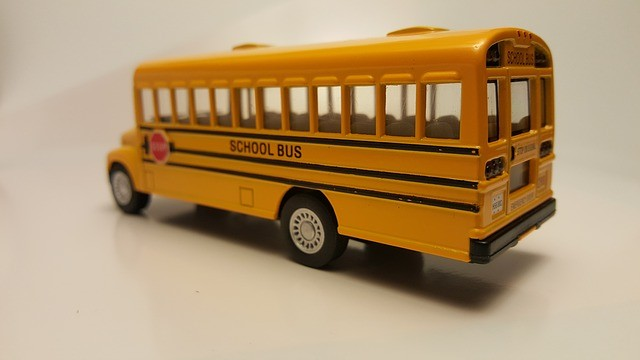 a toy of yellow bus